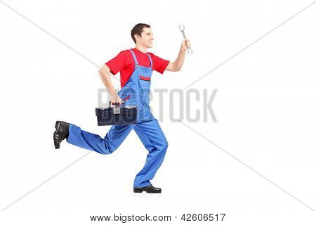 Full length portrait of a repairman running with a wrench and a tool box isolated on white background