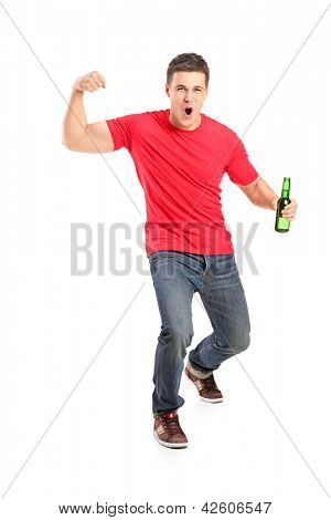Full length portrait an euphoric fan holding a beer bottle and cheering isolated on white background
