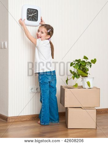 Little girl moving into new house. Hangs on a wall  watch