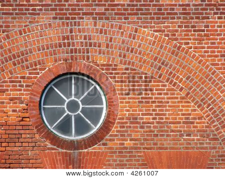Round Victorian Window In Red Brick Wall