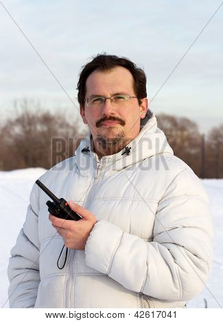 Man With Cb Radio Outdoors Winter Day