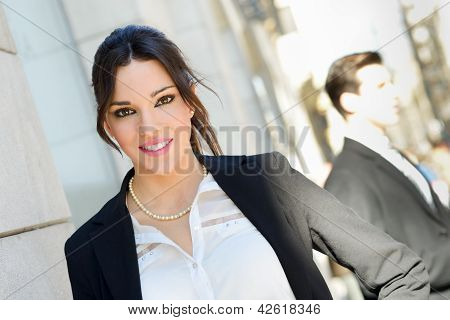 Attractive Businesswoman Standing Outside Of Company Building. Couple Working.