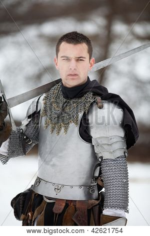 "DONJA STUBICA, CROATIA - FEBRUARY 9: Representation of the Croatian-Slovenian peasant revolt ""Seljacka buna"" of 1573, on February 9, 2013 in Donja Stubica, Croatia. Knight posing with a sword."