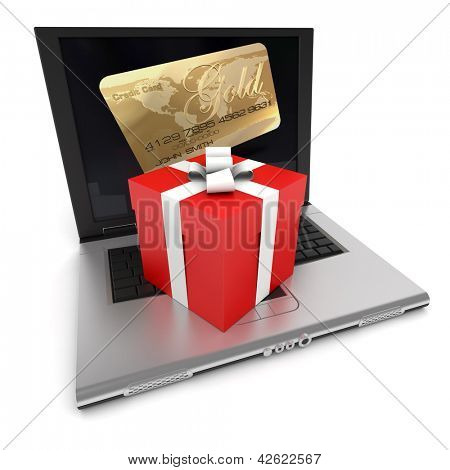 Open laptop with a credit card on the screen, and a gift box on top of the keyboard