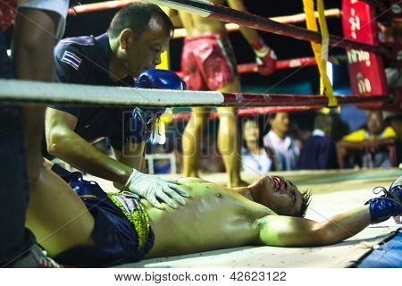 CHANG, THAILAND - FEB 22: Unidentified Muaythai fighters in the ring, Feb 22, 2013 on Chang, Thailand. For many Thai men, Muaythai - only way to break out of poverty, per battle pay 1500 to 7000 baht.