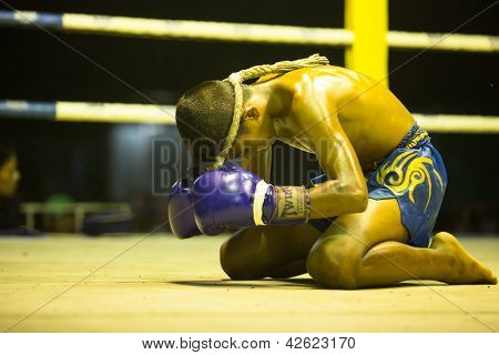 CHANG, THAILAND - FEB 22: Unidentified Muaythai fighter in ring during match, Feb 22, 2013 on Chang, Thailand. For many Thai men Muaythai only way to break out of poverty, per battle pay to 7000 baht.