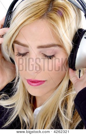 Close View Of Woman Tuned In Music