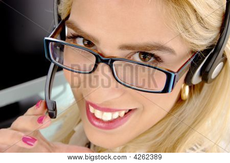 Close Up View Of Smiling Telecaller