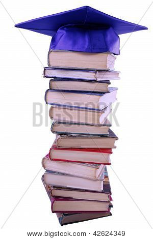 Graduation Cap On Top Of Book Stack