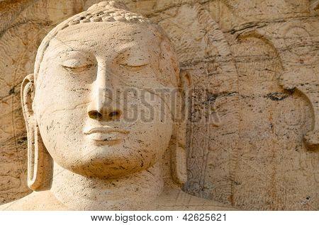 Buddha Face On Yellow Stone