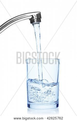 Glass filled with drinking water from tap, isolated on the white background, clipping path included.