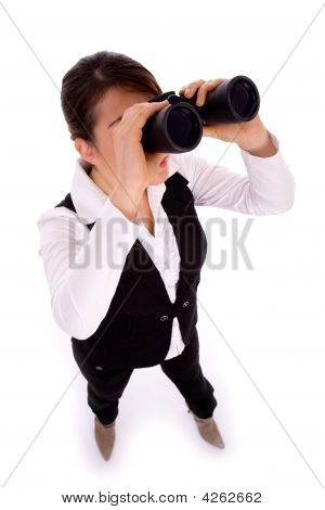 Full Body Pose Of Businesswoman Viewing Through Binoculars