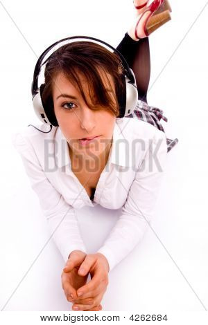 Front View Of Fashionable Female Enjoying Music