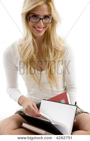 Front View Of Happy High School Student With Her Books