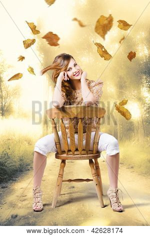 Beautiful Woman Sitting In Autumn Field