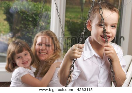 Young Boy Poses With Mom And Sister