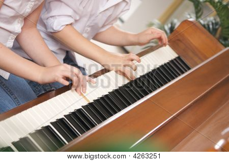 Children Playing The Piano