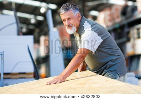 Senior man buying construction wood in a  DIY store