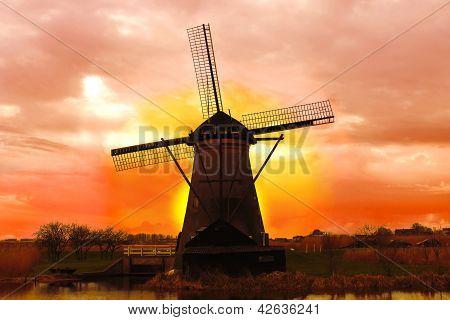 Windmill At Sunset. Dutch Landscape
