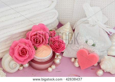 Rose flower spa and bathroom accessories with moisturiser.