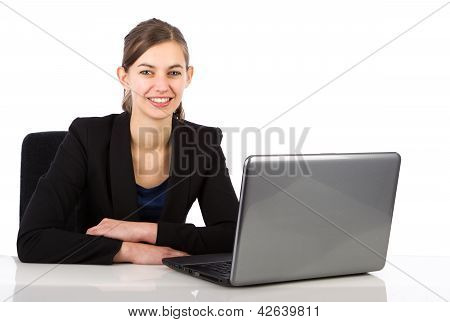 Young Attractive Business Woman Sitting Behind A Desk