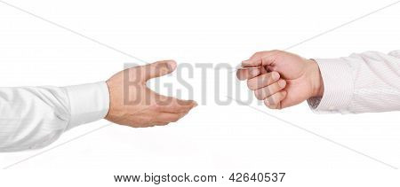 Male Hand Holding A Credit Card And Handing It Over To Another Person