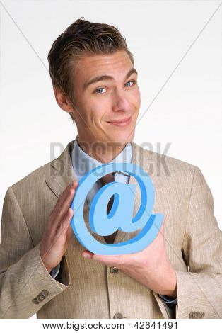Optimistic young businessman holding an email symbol.