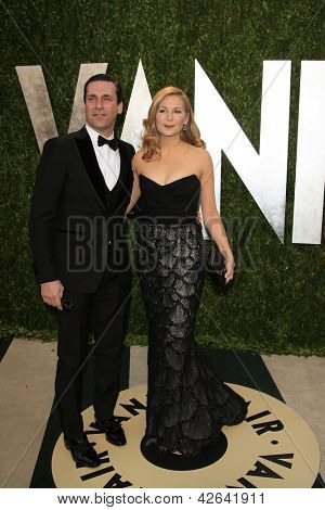 WEST HOLLYWOOD, CA - FEB 24: Jennifer Westfeldt, Jon Hamm at the Vanity Fair Oscar Party at Sunset Tower on February 24, 2013 in West Hollywood, California