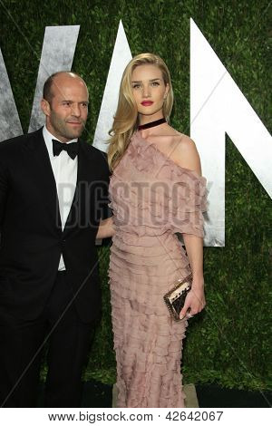 WEST HOLLYWOOD, CA - FEB 24: Jason Statham, Rosie Huntington-Whiteley at the Vanity Fair Oscar Party at Sunset Tower on February 24, 2013 in West Hollywood, California