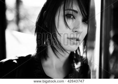 Young beautiful woman staring at camera.