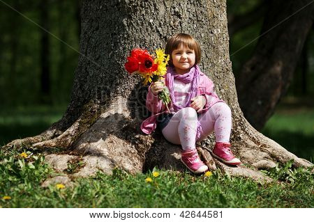 little sweet girl with flowers