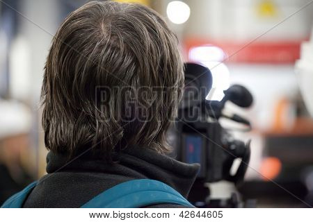 The image of a professional cameraman