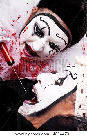 Evil Clown With Syringe Threatened Another Clown