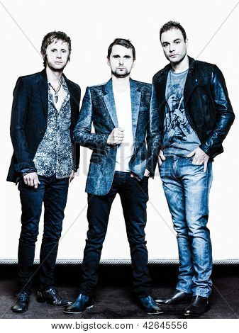 PARIS, FRANCE - JULY 04, 2012: Portrait of the english rock group Muse with  Matthew Bellamy, Dominic Howard and Christopher Wolstenholme at Paris, France on july 4th, 2012