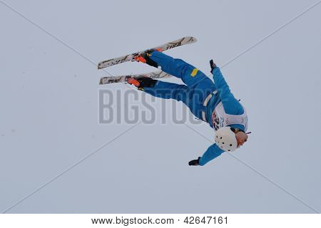 BUKOVEL, UKRAINE - FEBRUARY 23: Mykola Puzderko, Ukraine performs aerial skiing during Freestyle Ski World Cup in Bukovel, Ukraine on February 23, 2013.