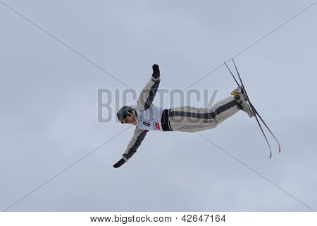 BUKOVEL, UKRAINE - FEBRUARY 23: David Morris, Australia performs aerial skiing during Freestyle Ski World Cup in Bukovel, Ukraine on February 23, 2013.