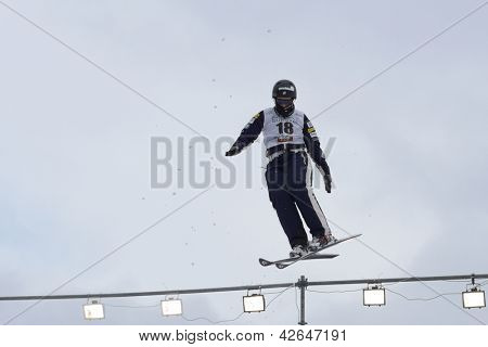 BUKOVEL, UKRAINE - FEBRUARY 23: Allison Lee, USA performs aerial skiing during Freestyle Ski World Cup in Bukovel, Ukraine on February 23, 2013
