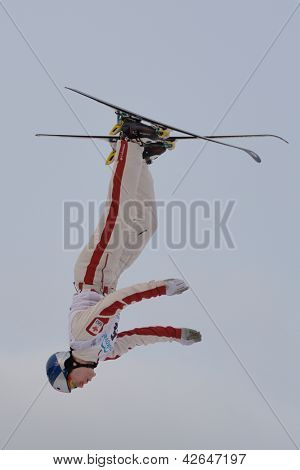BUKOVEL, UKRAINE - FEBRUARY 23: Travis Gerrits, Canada performs aerial skiing during Freestyle Ski World Cup in Bukovel, Ukraine on February 23, 2013.