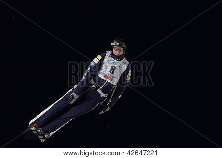 BUKOVEL, UKRAINE - FEBRUARY 23: Dylan Ferguson, USA performs aerial skiing during Freestyle Ski World Cup in Bukovel, Ukraine on February 23, 2013.