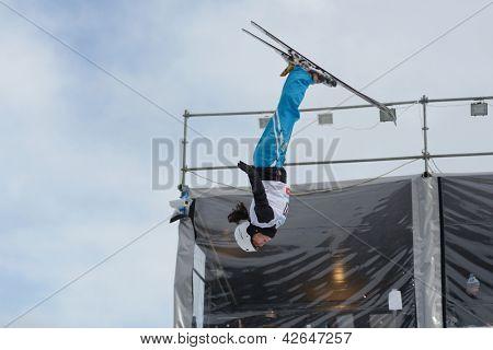BUKOVEL, UKRAINE - FEBRUARY 23: Zhibek Arapbayeva, Kazakhstan performs aerial skiing during Freestyle Ski World Cup in Bukovel, Ukraine on February 23, 2013.