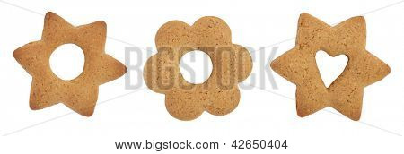 Three cookies with holes shaped as circle and heart