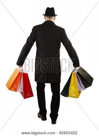 Man buyer is holding colorful shopping bags