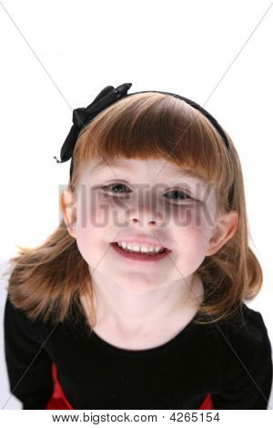 Close Up Of Pretty Little Girl With Black Hair Bow