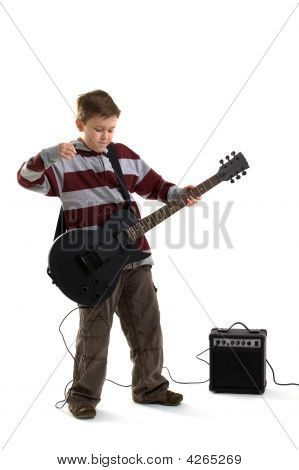 Boy Playing An Electric Guitar Isolated