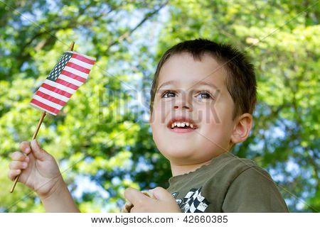 Little boy waving an American flag