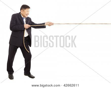 Asian businessman pulling a rope isolated on white background