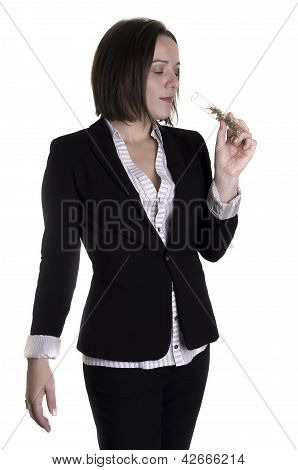 Woman smelling parfum