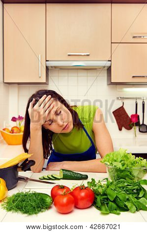 fatigued woman in the kitchen