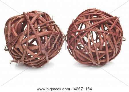Two Brown Spheres Made From Wicker