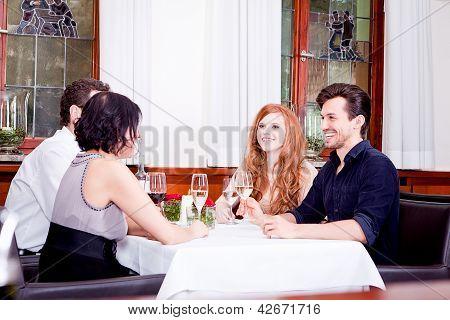 Smiling Happy People In Restaurant